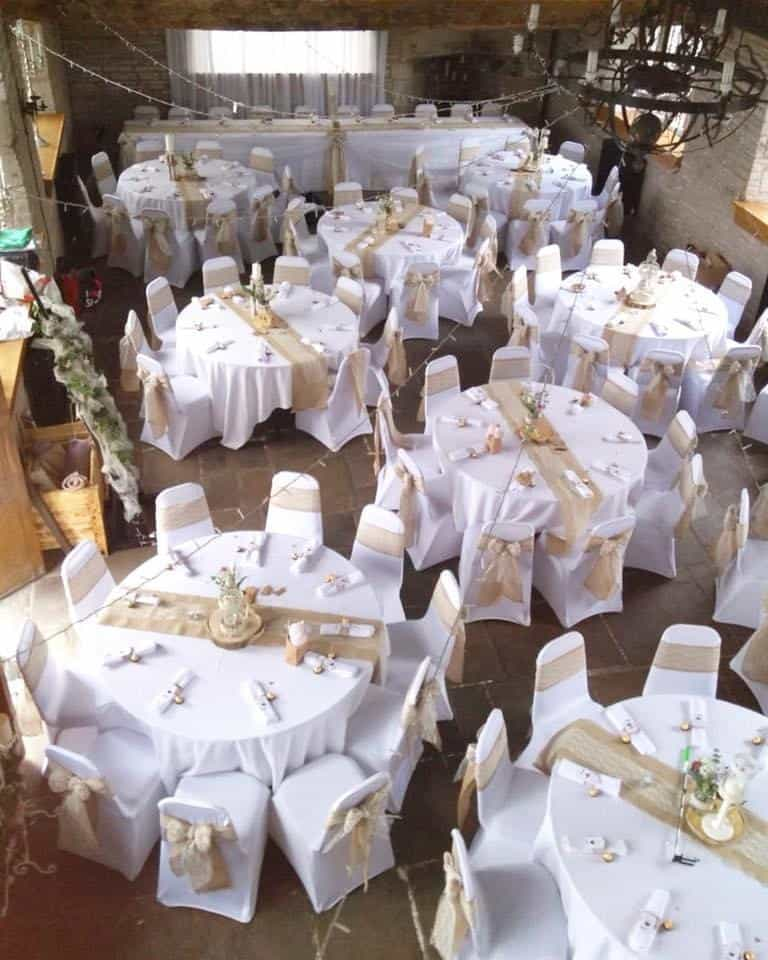 Wedding breakfast venue dressing with white and gold decoration, from a birds eye view in a pub