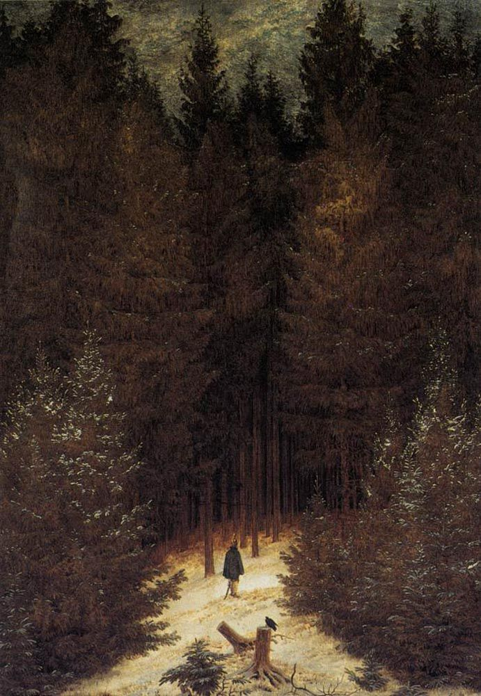 A lone hunter is seen among tall, dark trees in a winter landscape.
