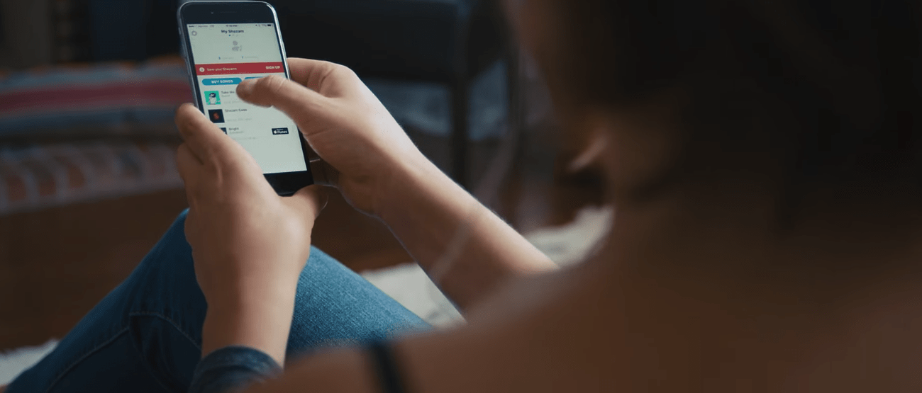 Person sitting and using a smart phone