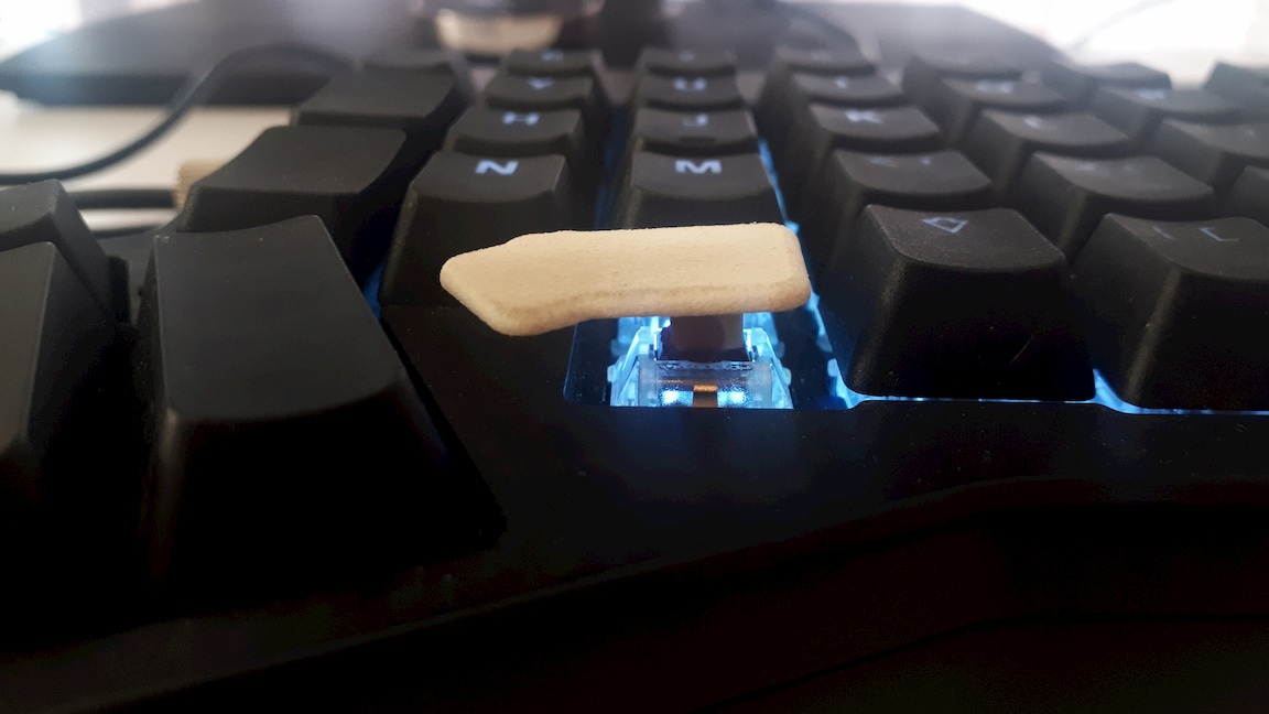 The keycap occupies much of the gap I dislike, but is a little bit skewed.