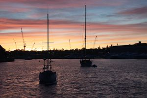 Wattle bay harbour with two boats under a cotton candy sky