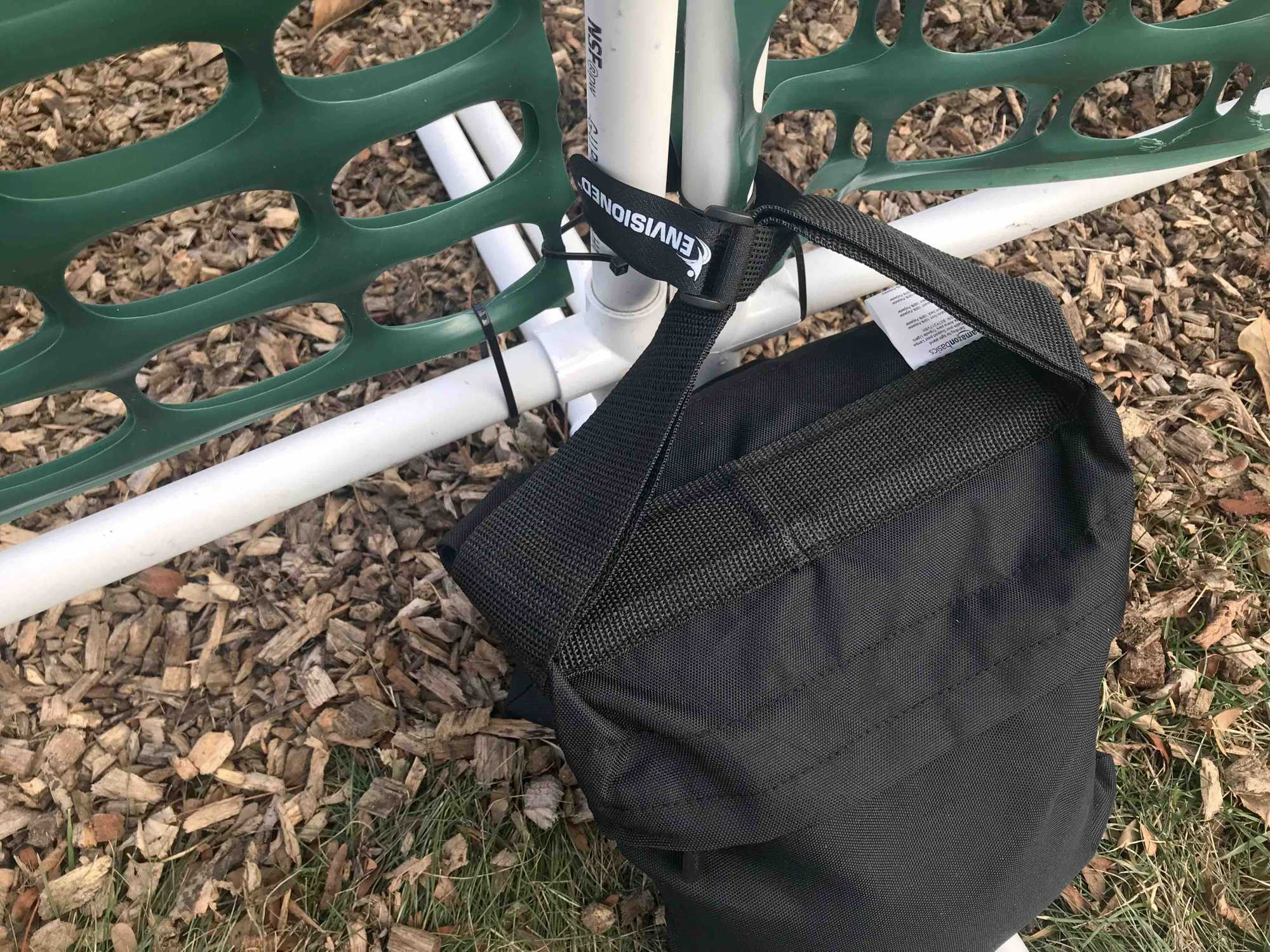 Velcro strap connecting gates and sandbag