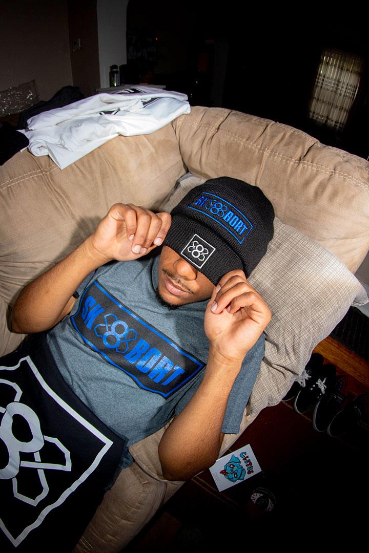 CJ Brown modling Sk8bort hat and shirt