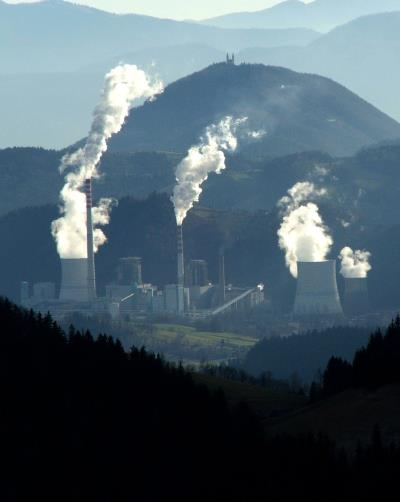Power plant with various emissions being produced, from le-si of FreeImages.com