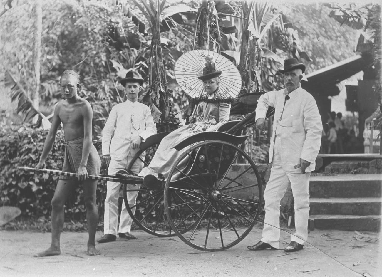 A rickshaw puller and his passengers, 1900s