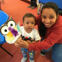 A woman and toddler with a cardboard owl