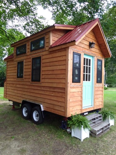 External view of this tiny house on a trailer (from Lancaster, South Carolina, based off the 'Tiny Living' plans), showing 6 windows and the windowed front door.