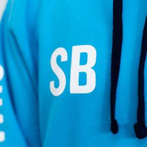 An example of student's initials printed on the front right chest of a hoodie.