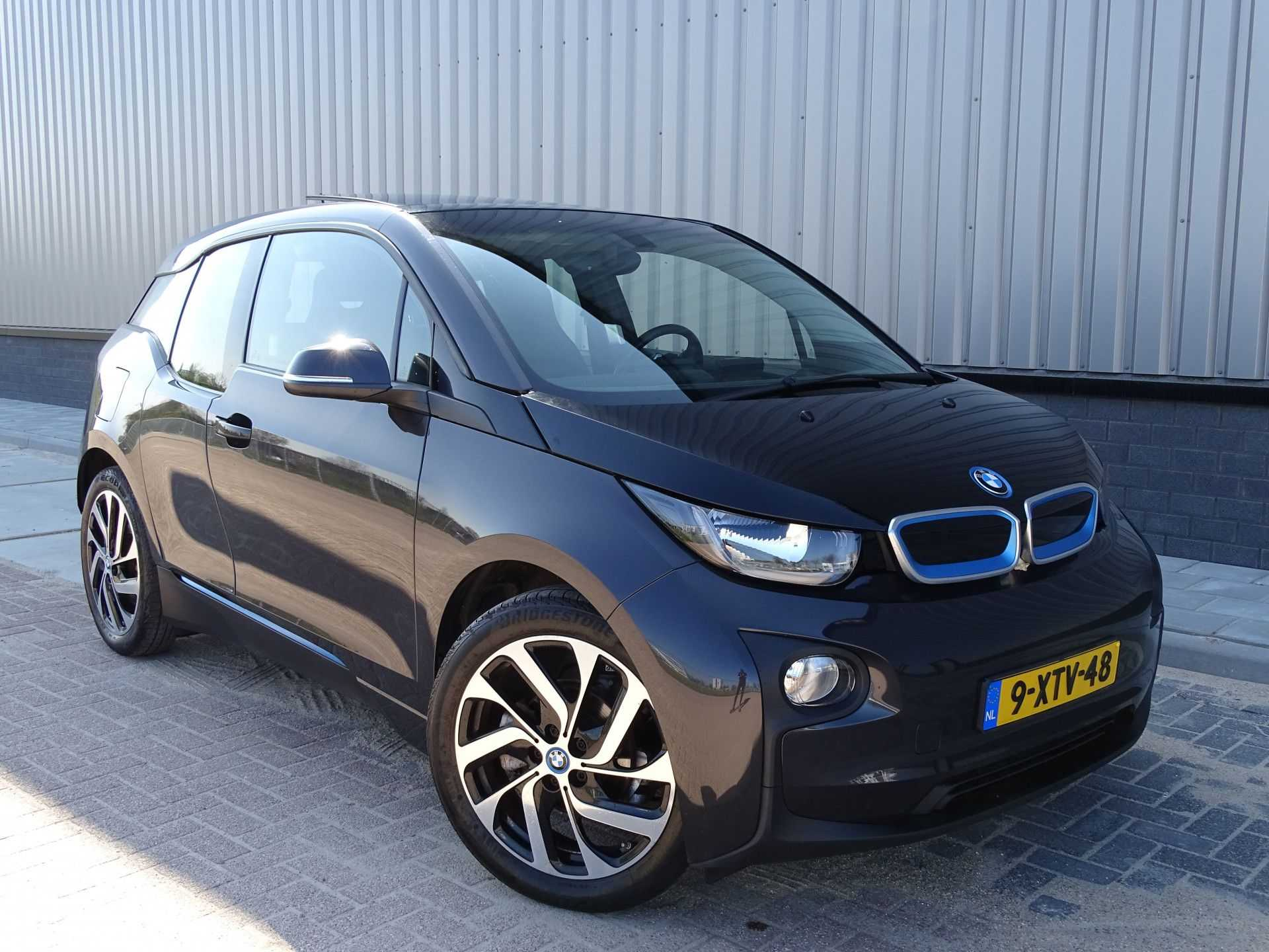 BMW i3 Basis Comfort Advance 22 kWh Marge Warmtepomp Navigatie Clima Cruise Panorama afbeelding 1