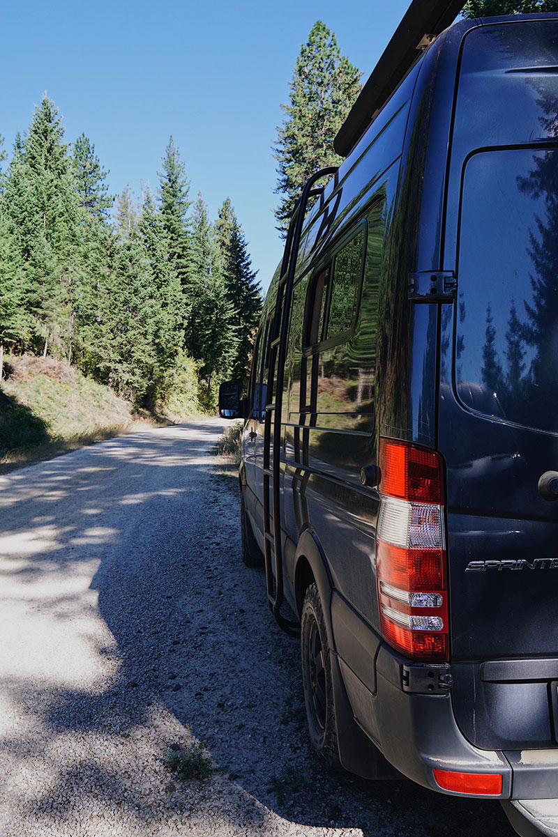 Parking sprinter van on side of road to camp in the National Forest