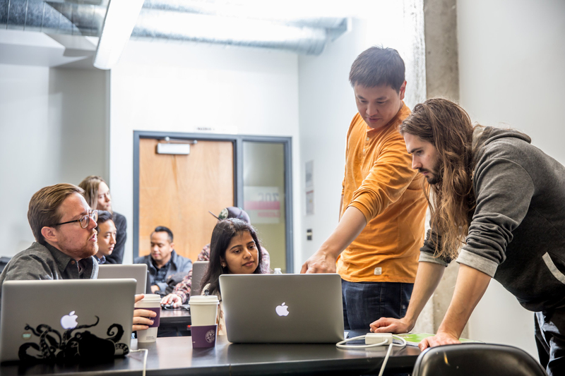 Instructor working with students