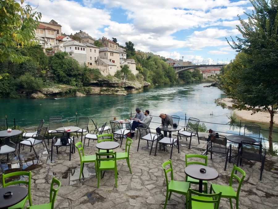 A coffee shop situated on the river in Mostar