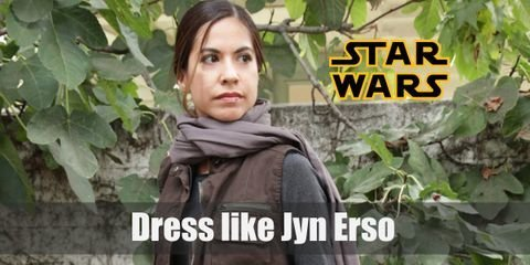 Cosplaying Jyn Erso would be a great choice. This character wears several very attractive pieces of clothes. She combines some common pieces of rebel uniforms with plenty of her signature details.