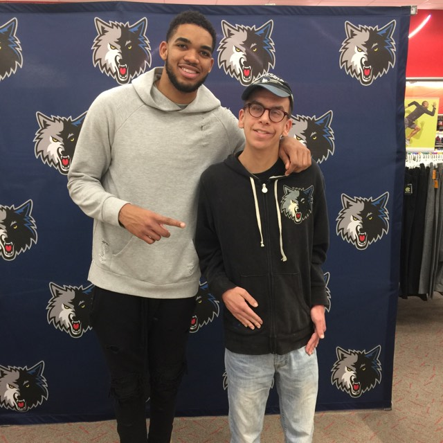 Peter Froehlich with Karl-Anthony Towns, a player for the Minnesota Timberwolves