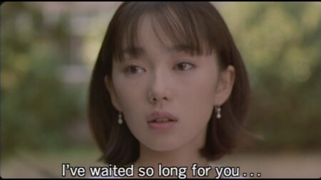 "A close up of Kiyomi saying the line ""I've waited so long for you…"""