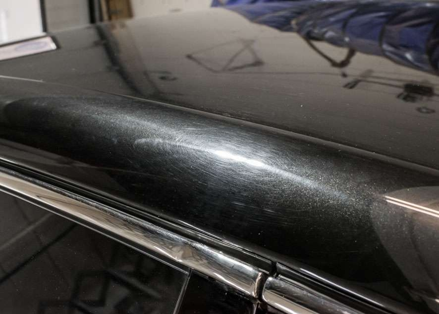 Close up shot of Bentley Flying Spur car with scratches and swirls on roof