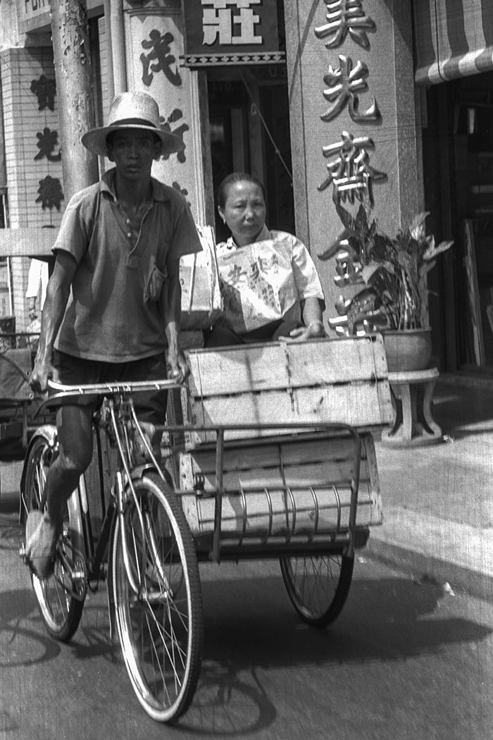 Trishaw rider and passenger, 1961