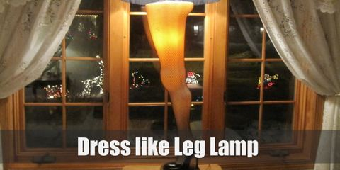For a leg lamp costume, all you need to wear is either a gold dress or gold skirt with a black fringe on the bottom, black fishnet stockings, and black heels.
