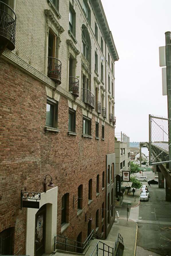 The side of a brick apartment building with small windows