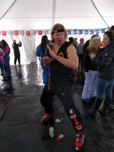 Johnny Lawrence, in full Cobra Kai gi, crushes 80s Day with Pants and Fizz