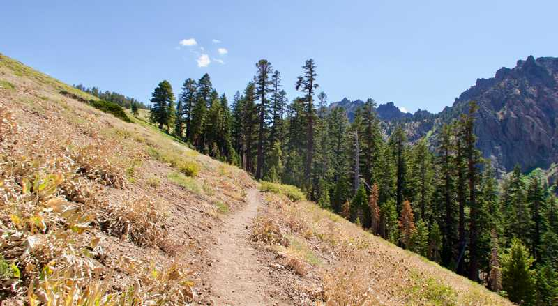The trail continues over a ridge