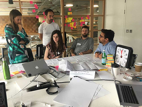 Member of the farfetch product team demoing a paper prototype