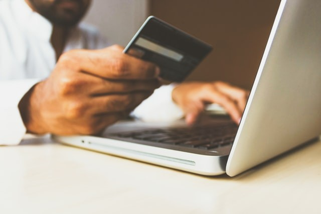 Man with credit card borrowing money online