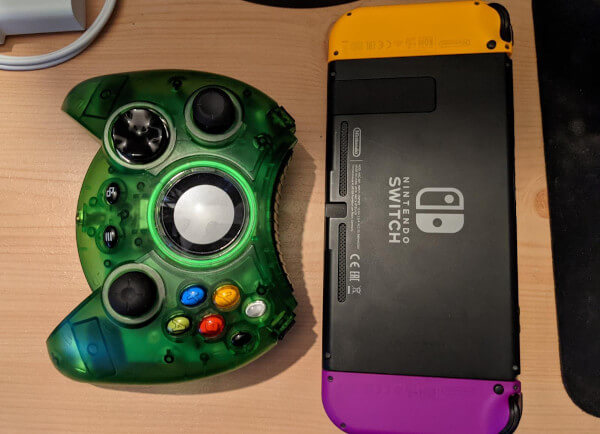 Comparing the size of the Hyperkin Duke controller to a Nintendo Switch - the Hyperkin Duke is bulkier than the Switch, for sure
