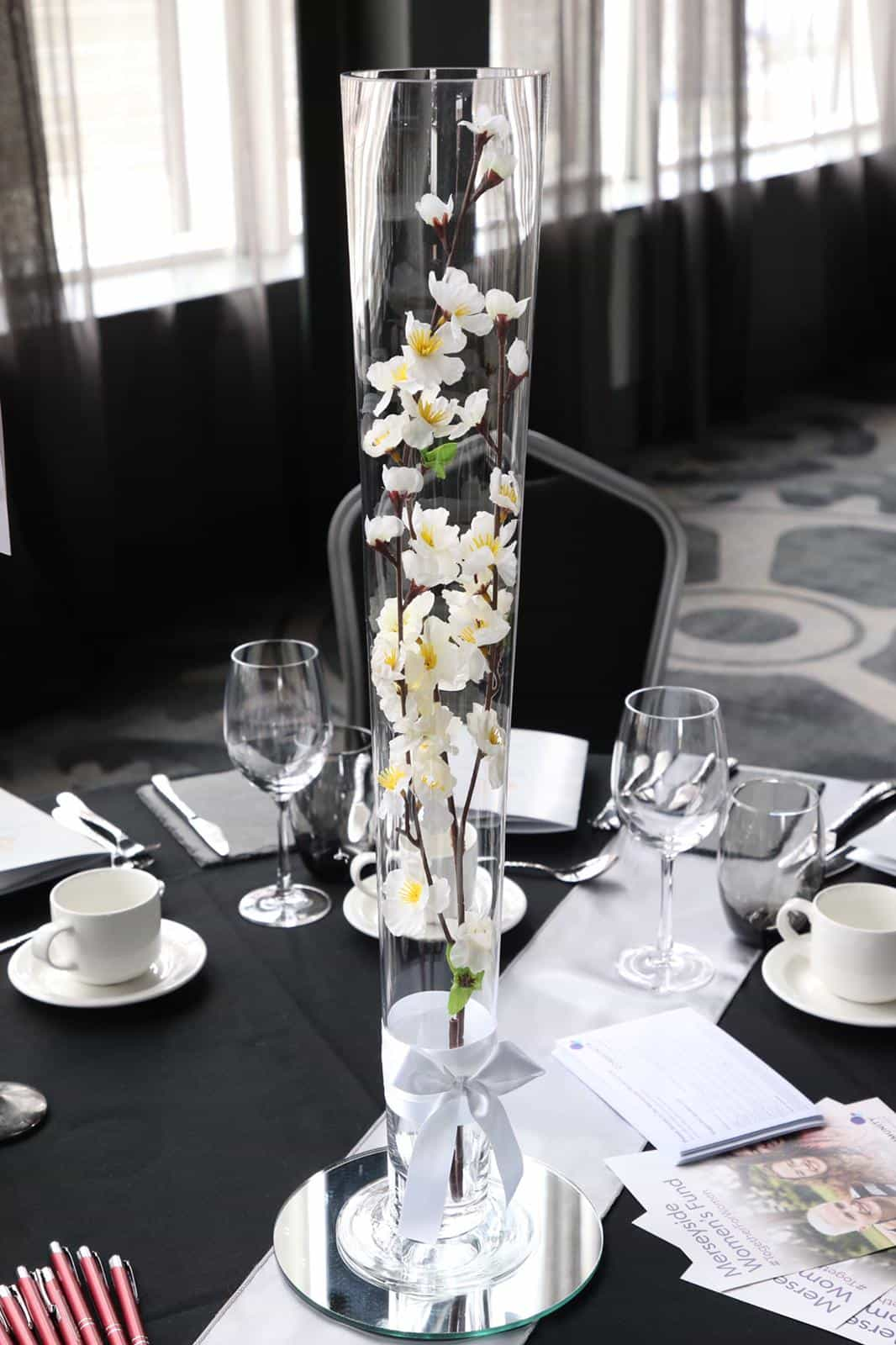 Wedding breakfast table centrepiece tall 70cm vase with white lily flower inside