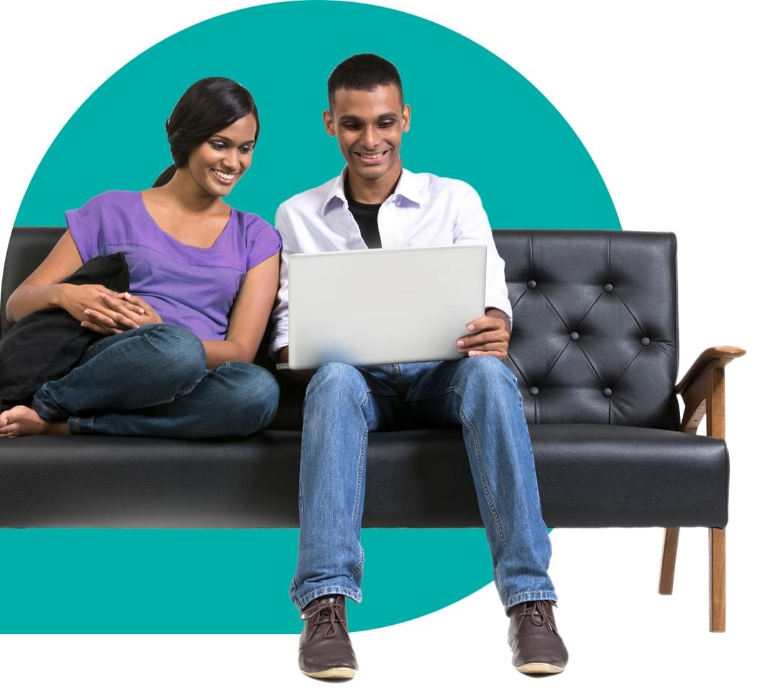 Happy couple shopping online on couch