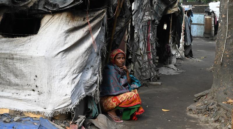 Woman sits in waste picker neighborhood