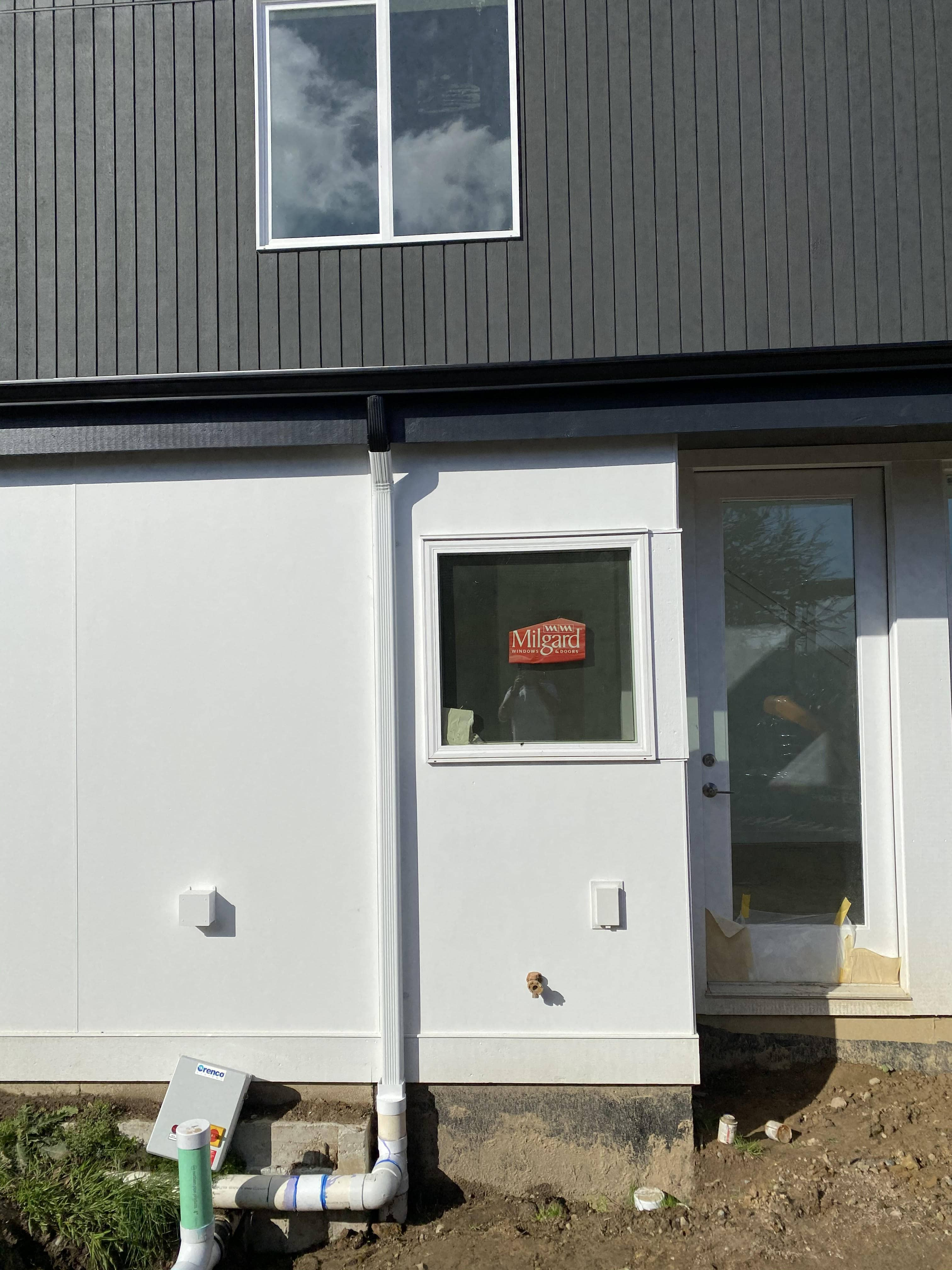 enlarged photo of woden siding home freshly stained