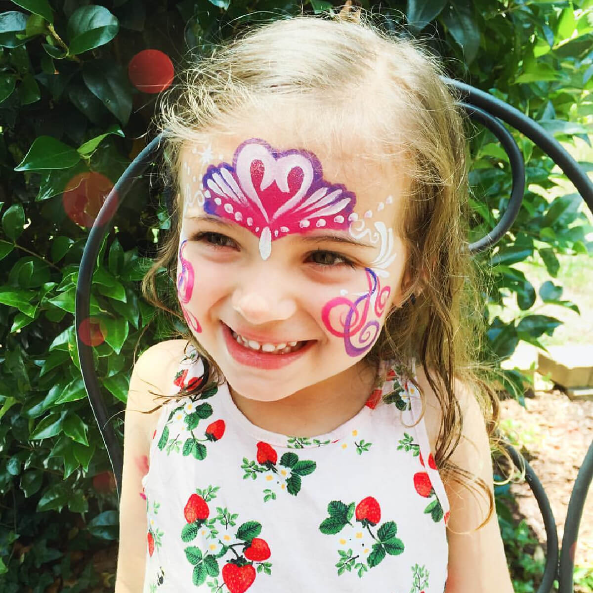 child with princess face painting