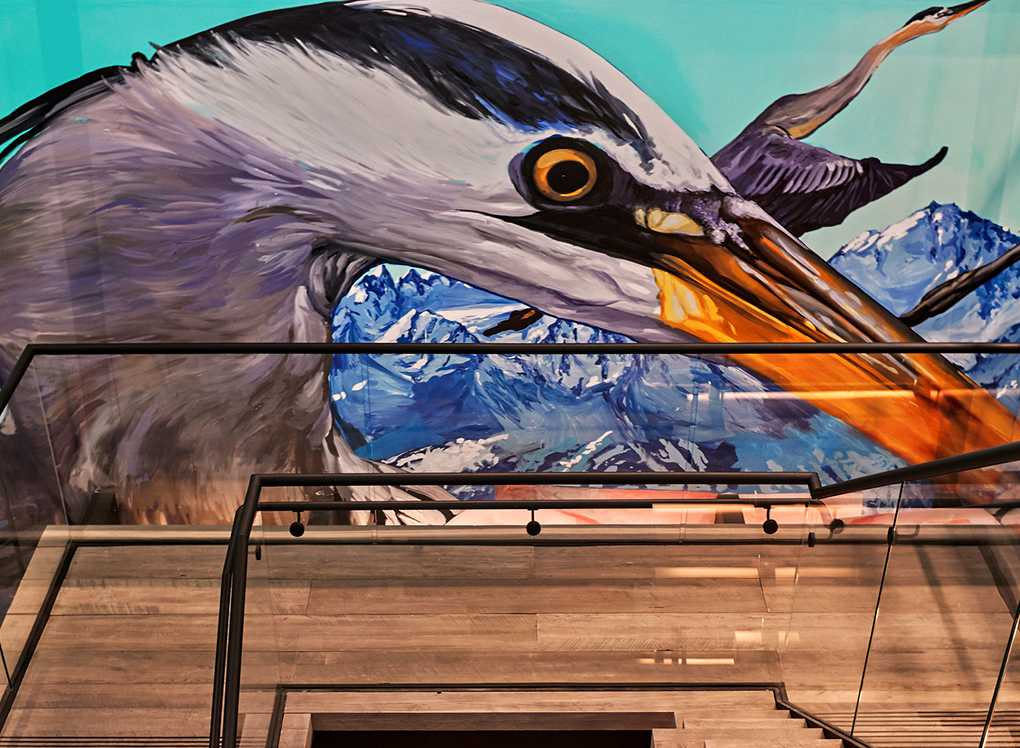 Mural of graceful bird on interior wall