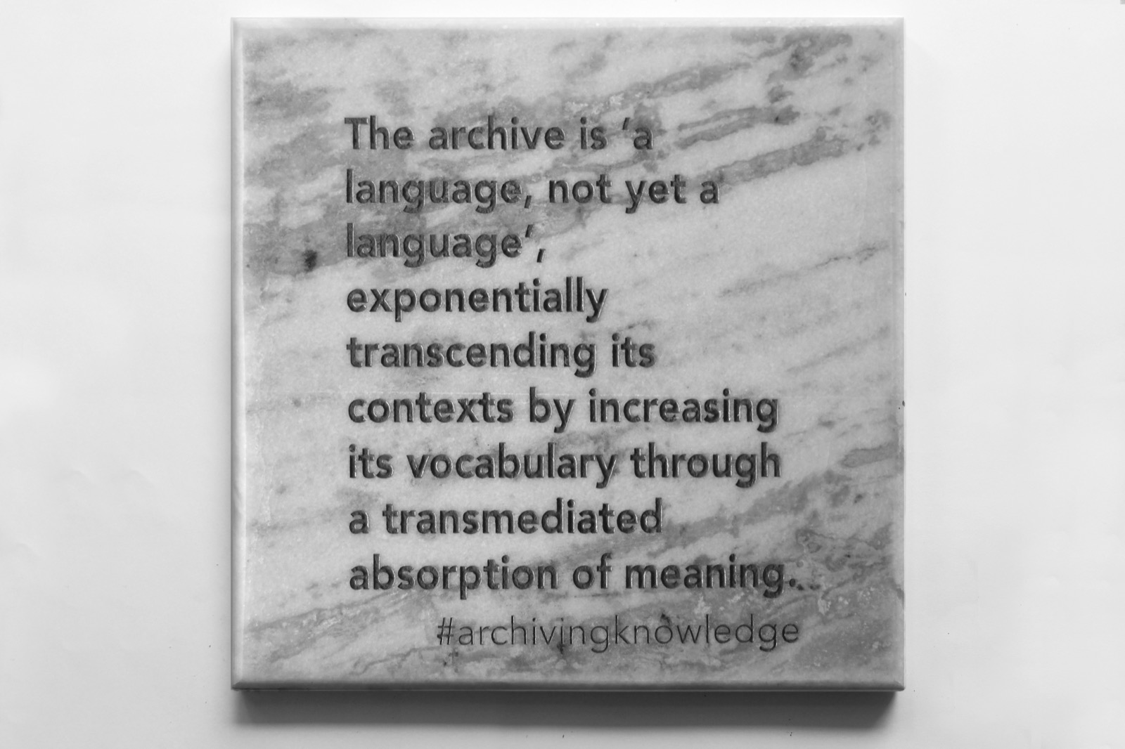 The archive is 'a language, not yet a language', exponentially transcending its contexts by increasing its vocabulary through a transmediated absorption of meaning, From the series: Archiving Knowledge, hand engraved marble, 2018