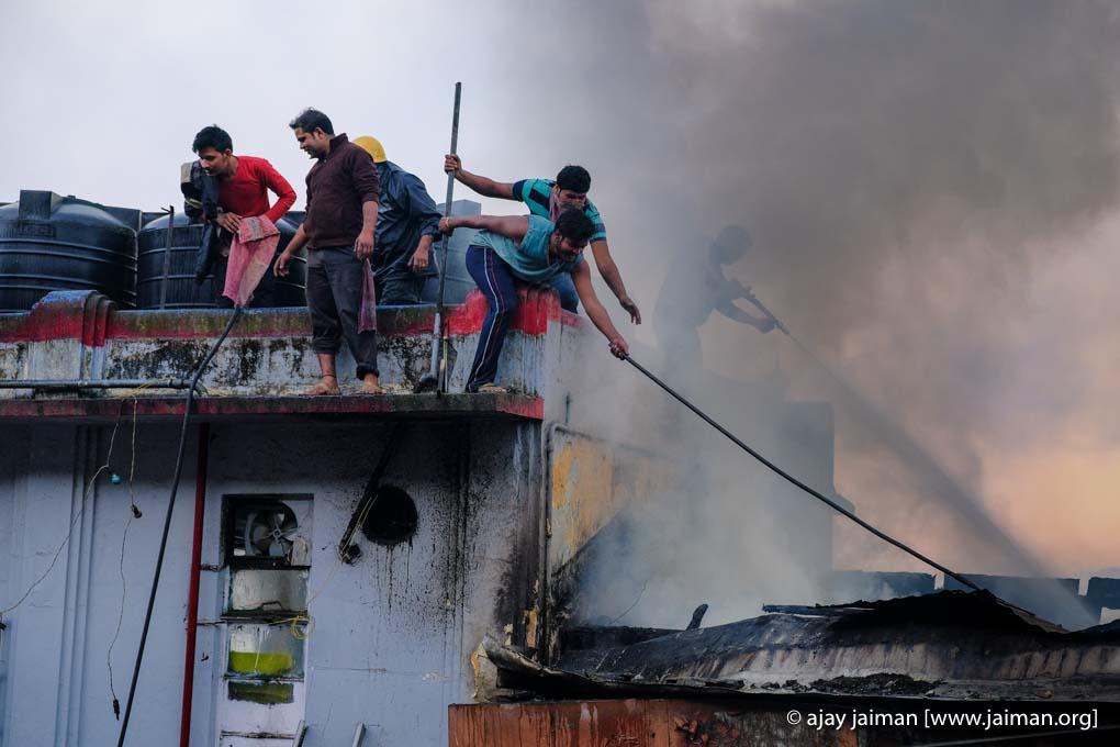 Helpless onlookers watching fire devastating shops in Darjeeling