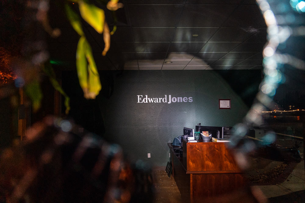 The interior of the Edward Jones office is seen through a broken window in Oakland, Calif., August 26, 2020. Protesters broke some windows and set small fires in the street as they were dispersed down Grand Avenue by Oakland police.
