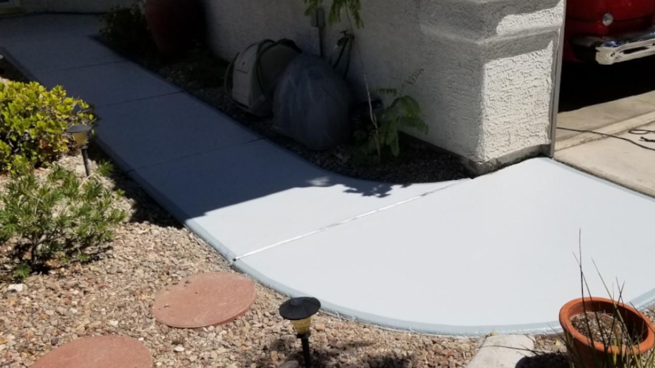 Concrete walkway restoration from prolonged water damage
