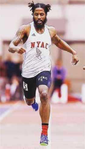 Man running indoor track field