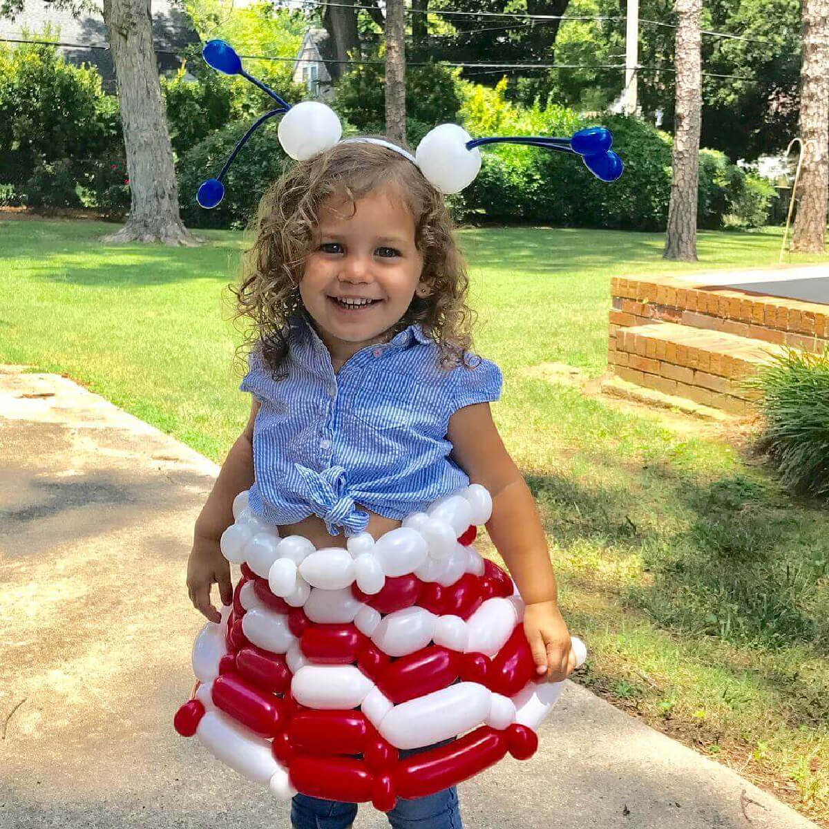 child wearing balloon dress