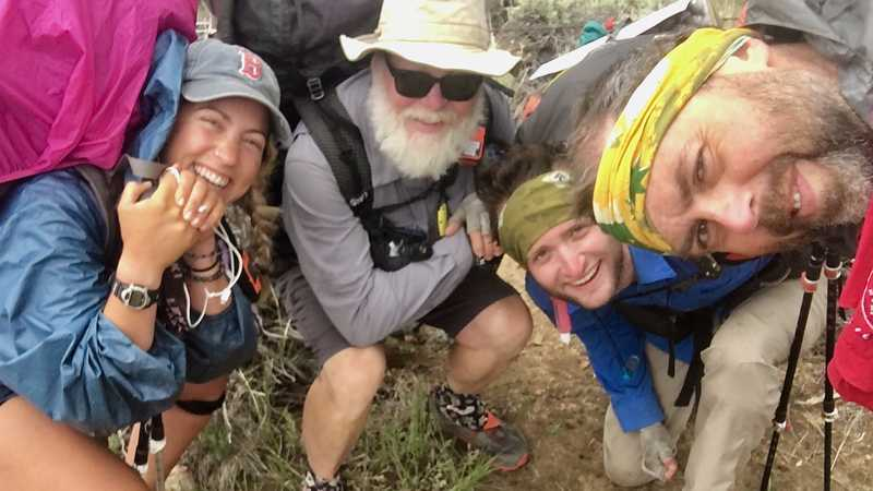 Group selfie at mile 700 marker