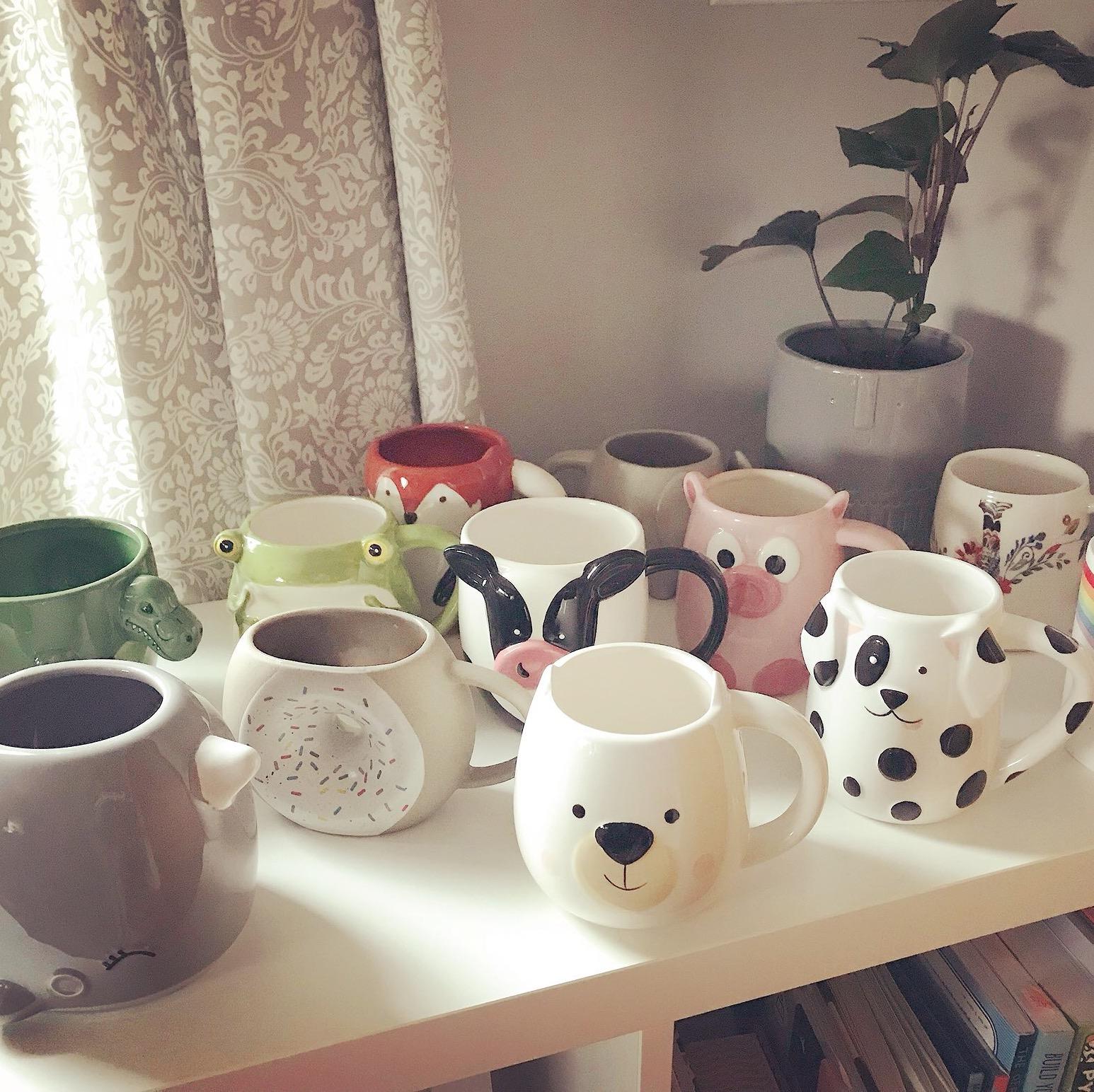 Photo of a large animal mug collection