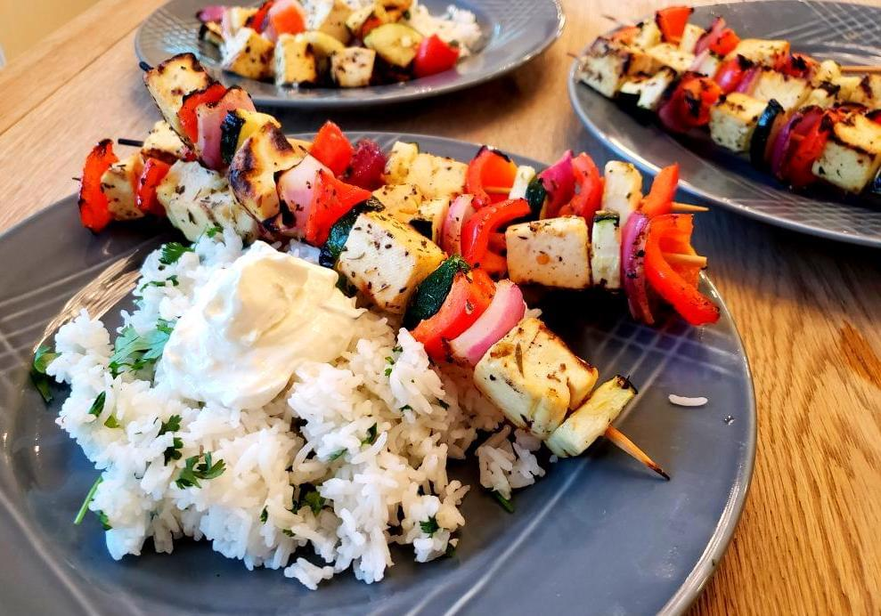 Plate of Mediterranean skewers with tofu and vegtables and side of rice
