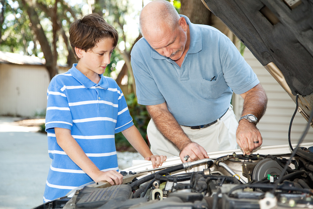 Father son vehicle maintenance
