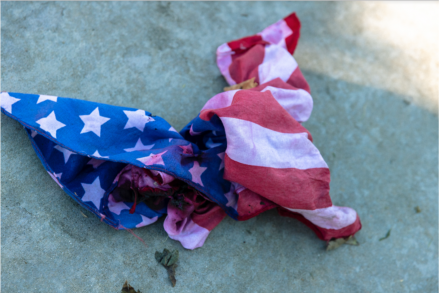 Tattered; smoke-stained American flag.