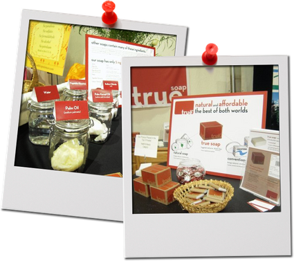 Two photographs tacked up depicting the trade show materials of TrueBody Products