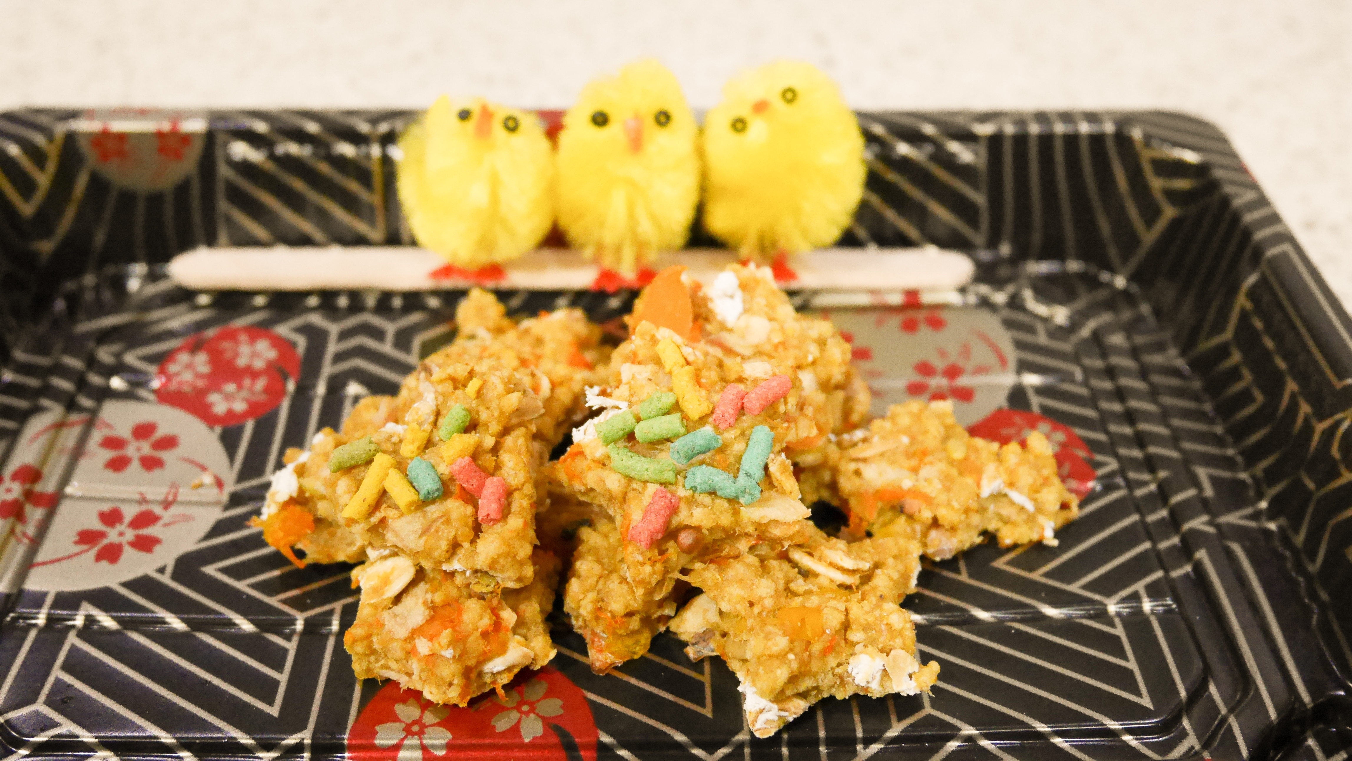 Healthy parrot cookies and toy baby chicken for decoration