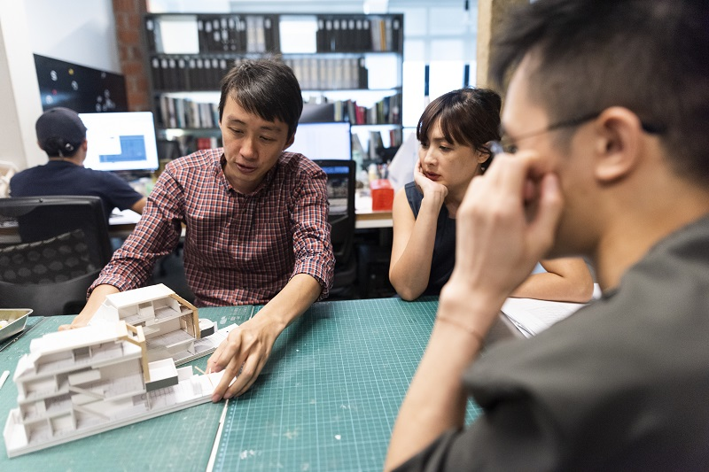 Architect Joseph Lee at his office in discussion