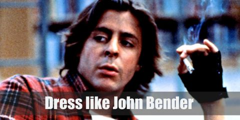 John Bender dresses quite ruggedly and in many layers, but it still looks cool on him. He wears a white sweater, a red plaid shirt, a denim jacket, and grey pants.