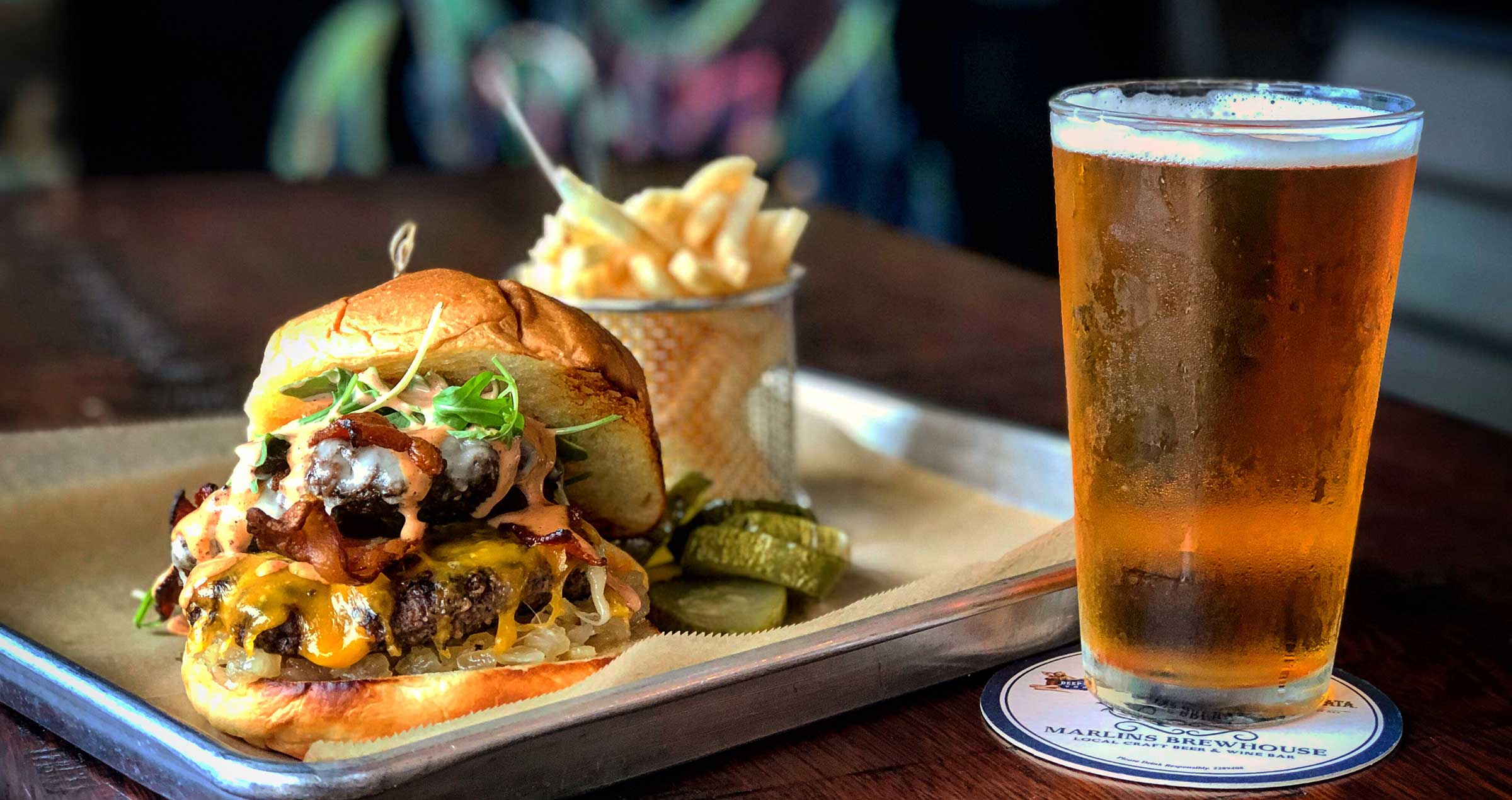 Bacon Cheese Hamburger with fries and a cold beer